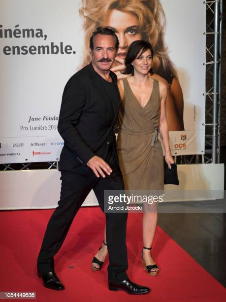 Jean Dujardin and wife Nathalie Péchalat attends the opening ceremony during the 10th Film Festival Lumiere on October 13, 2018 in Lyon, France.