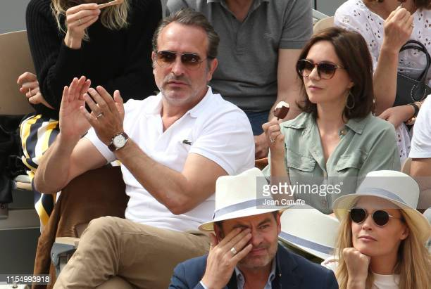 Jean Dujardin and wife Nathalie Pechalat attend the men's final during day 15 of the 2019 French Open at Roland Garros stadium on June 9 2019 in...