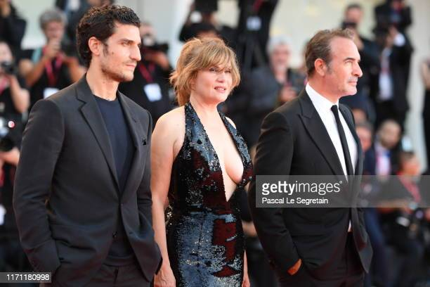 Jean Dujardin Emmanuelle Seigner and Louis Garrel walk the red carpet ahead of the J'Accuse screening during the 76th Venice Film Festival at Sala...