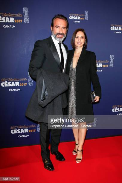 Jean Dujardin et Nathalie Pechalat arrive at the Cesar Film Awards 2017 ceremony at Salle Pleyel on February 24 2017 in Paris France