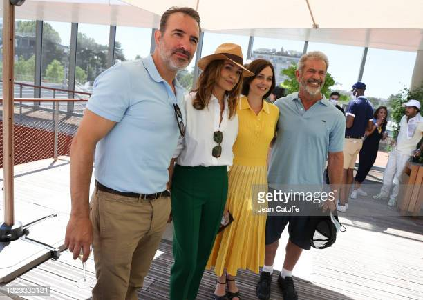 Jean Dujardin, Nadia Fares, Nathalie Pechalat, wife of Dujardin, Mel Gibson attend the Men's Singles Final during day 15 of the 2021 Roland-Garros,...
