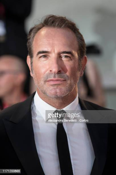 Jean Dujardin walks the red carpet ahead of the J'Accuse screening during the 76th Venice Film Festival at Sala Grande on August 30 2019 in Venice...