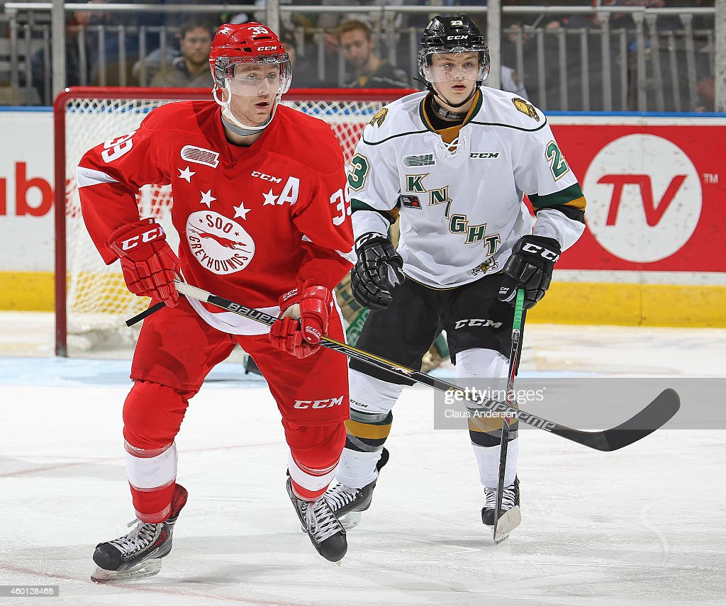 Jean Dupuy #39 of the Sault Ste. Marie Greyhounds skates against Drake Rymsha #23 of the London Knights in an OHL game at Budweiser Gardens on December 5, 2014 in London, Ontario, Canada. The Greyhounds defeated the Knights 4-0.