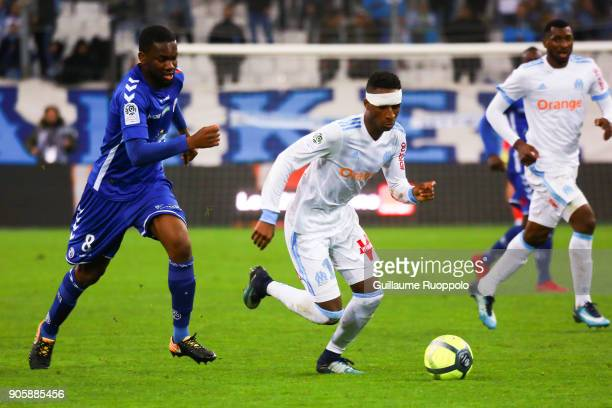 Jean Eudes Aholou of Strasbourg and Bouna Sarr of Marseille during the Ligue 1 match between Olympique Marseille and Strasbourg at Stade Velodrome on...