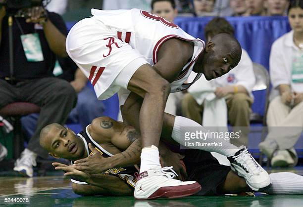Jean Felix of the Alabama Crimson Tide ties up Ed McCants of the MilwaukeeWisconsin Panthers as he tries to call time out during the first round of...