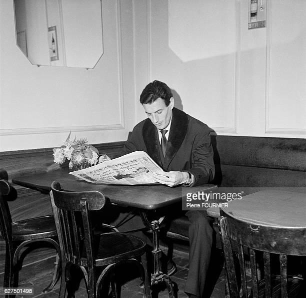 Jean Ferrat in a Cafe