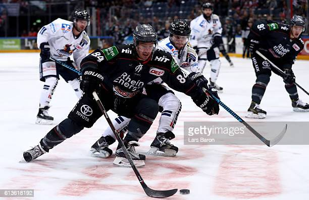 Jean Francois Boucher of Koeln is challenged by Dieter Orendorz of Iserlohn during the DEL match between Koelner Haie and Iserlohn Roosters at...