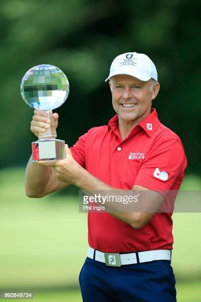 Jean Francois Remesy of France poses with the trophy after the final round on Day Three of the Swiss Seniors Open at Golf Club Bad Ragaz on July 8...
