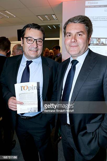 Jean François Guillot and Franck Louvrier attend 'L'Opinion' Newspaper Launch Party on May 14 2013 in Paris France