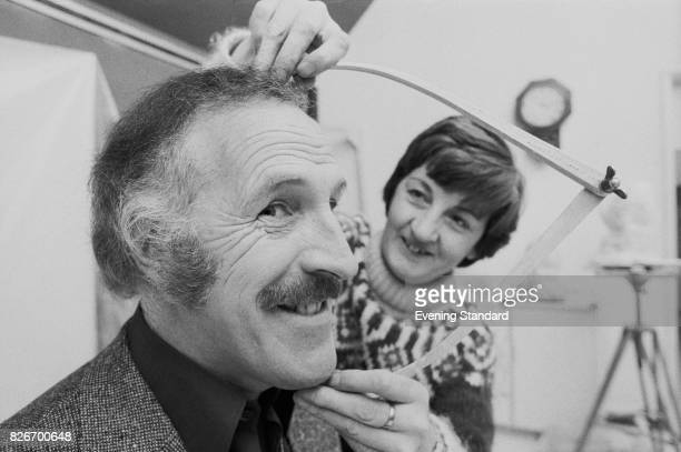 Jean Fraser of Madame Tussaud's measures comedian Bruce Forsyth's head before starting work on the first stage of his wax figure 8th February 1978
