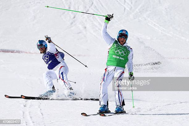 Jean Frederic Chapuis of France celebrates winning the gold medal followed by silver medallist Arnaud Bovolenta of France during the Freestyle Skiing...