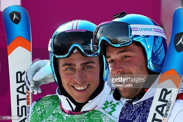 Jean Frederic Chapuis of France celebrates winning the gold medal with silver medallist Arnaud Bovolenta of France during the Freestyle Skiing Men's...