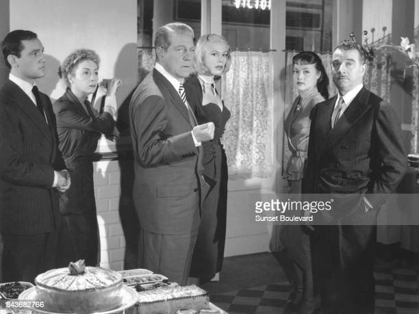 Jean Gabin on the set of Touchez pas au grisbi directed by Jacques Becker.