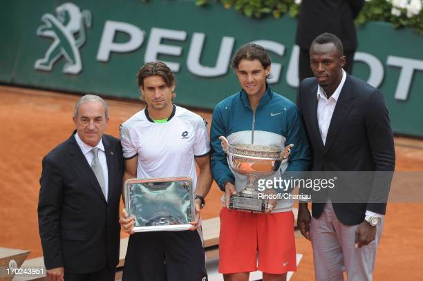 Jean Gachassin, David Ferrer, Rafael Nadal and Usain Bolt pose after the final match of french open 2013 at Roland Garros on June 9, 2013 in Paris,...