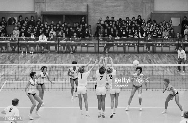 Jean Gaertner, Mary Peppler and Mary Perry of the United States attempt to block the ball against the attack of Rumania during their Women's Olympic...