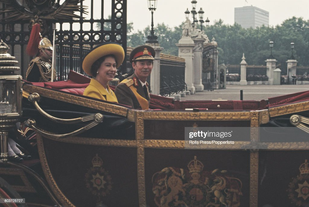 Jean, Grand Duke of Luxembourg rides with Queen Elizabeth II in an open carriage through the gates of Buckingham Palace, at the start of a four-day visit to London on 13th June 1972.