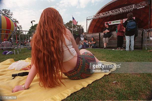 Jean Grundy a Boston University student waits for the Green Day concert to begin at the Hatch Shell on the Esplanade