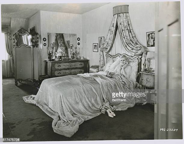 Jean Harlow American actress known as the sex symbol of the 1930s is seen here lounging in bed with her telephone