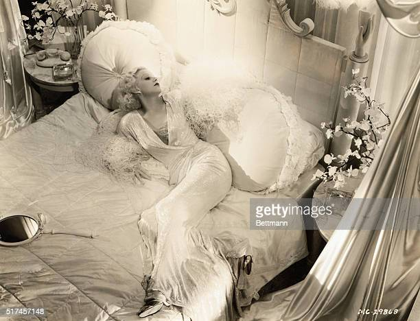 Jean Harlow American actress known as the sex symbol of the 1930s shown lounging on a bed in this publicity photo