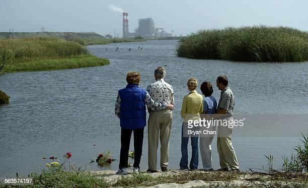 Jean Harris left Bill Armbrust daughter Vikki McCarter Carol and her husband Kurt Armbrust share a quiet moment after placing flowers in memory of...
