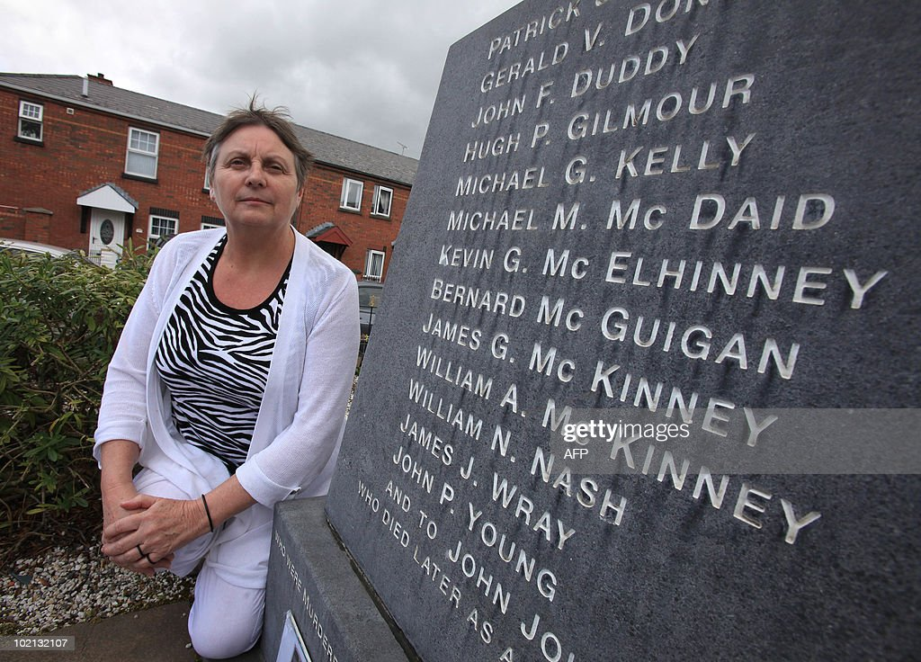 Jean Hegarty, sister of Kevin McElhinney, stands in front of a memorial depicting the name of her brother and 13 others shot by the British army on 30 January 1972 in the Bogside area of Londonderry, in Northern Ireland. The Saville Inquiry into Bloody Sunday will be published on June 15, 2010 after 12 years and a cost of £190 million pounds (275 million dollars, 230 million euros), the 5,000-page report examines the events of January 30, 1972 in Londonderry, Northern Ireland, when 13 civilians were shot dead by British soldiers at a civil rights march. Another man died later from his wounds. AFP PHOTO/ Peter Muhly
