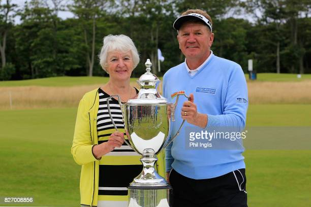 Jean Holloway Scottish Ambassador Prostate Cancer UK poses for a photograph with Paul Broadhurst of England after the final round of the Scottish...