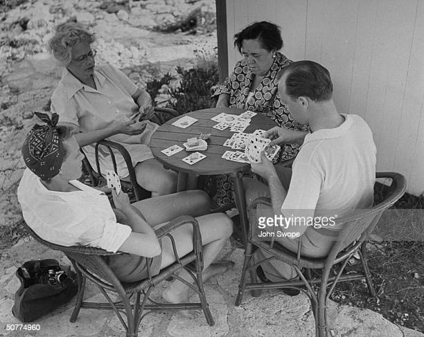 Jean Howard Mrs Richard FellowesGordon Elsa Maxwell and Jimmy Donahue playing cards
