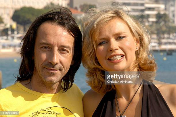 "Jean Hugues Anglade and Veronica Ferres during 2004 MIPCOM - ""Under the Dark Sun of Africa"" - Photo Call at Majestic Hotel Jetty in Cannes, France."
