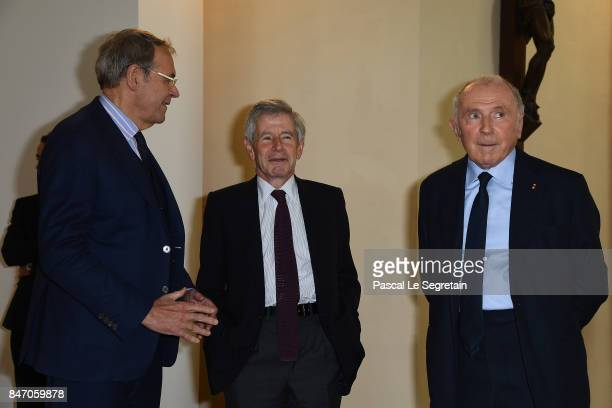 Jean Jacques Aillagon Alain Minc and Francois Pinault attend the exhibition 'Faire Avec' works from the Pinault Collection at 40 Rue de Sevres on...