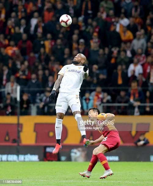 Jean Kana Biyik of Istikbal Mobilya Kayserispor in action against Yuto Nagatomo of Galatasaray during Turkish Super Lig soccer match between...