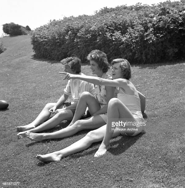 Jean Kennedy, Jacqueline Bouvier and Eunice Kennedy on vacation at the Kennedy compound in June 1953 in Hyannis Port, Massachusetts.