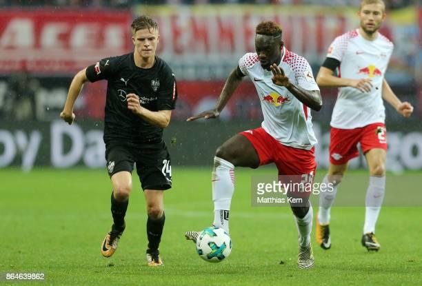 Jean Kevin Augustin of Leipzig battles for the ball with Dzenis Burnic of Stuttgart during the Bundesliga match between RB Leipzig and VfB Stuttgart...