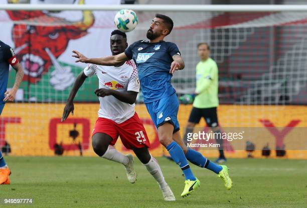 Jean Kevin Augustin of Leipzig battles for the ball with Kerem Demirbay of Hoffenheim during the Bundesliga match between RB Leipzig and TSG 1899...