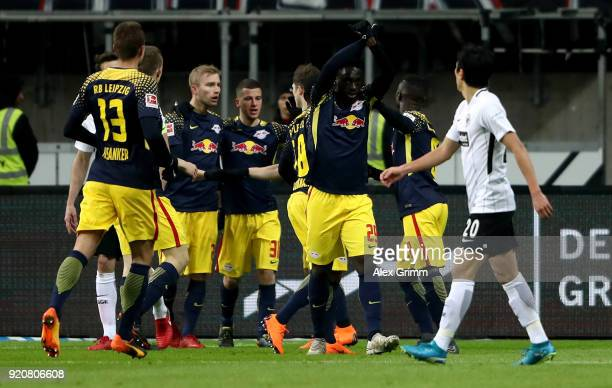 Jean Kevin Augustin of Leipzig celebratw with his team mates after he scores the openinig goal during the Bundesliga match between Eintracht...