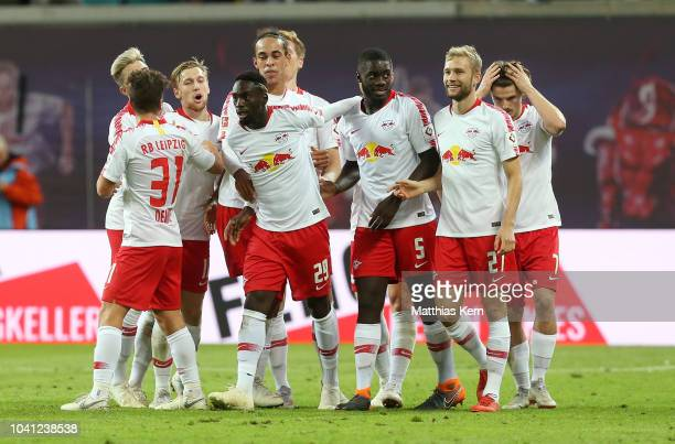 Jean Kevin Augustin of Leipzig jubilates with team ates after scoring the second goal during the Bundesliga match between RB Leipzig and VfB...
