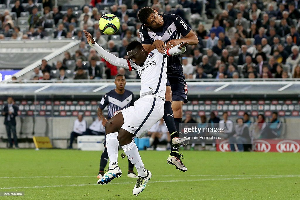 Jean Kevin Augustin (L) of Paris Saint Germain battles for the ball with Pablo of Girondins de Bordeaux during the French Ligue 1 match between FC Girondins de Bordeaux and Paris Saint-Germain at stade Matmut Atlantique on May 11, 2016 in Bordeaux, France.