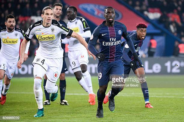 Jean Kevin Augustin of PSG and Mateo Pavlovic of Angers during the Ligue 1 match between Paris SaintGermain and Angers SCO at Parc des Princes on...