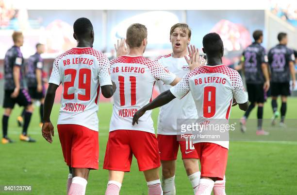 Jean Kevin Augustin Timo Werner Emil Forsberg and Naby Keita of RB Leipzig celebrate their team's third goal during the Bundesliga match between RB...