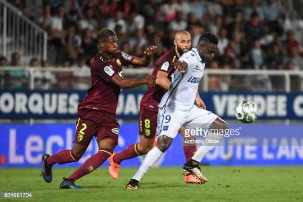 Jean Kevin Duverne and John Bostock of Lens and Pape Sane of Auxerre during the French Ligue 2 match between match between Auxerre and Lens at Stade...