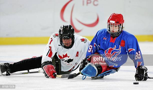 Jean Labonte of Canada in action against Nathan Stephens of Great Britain during a sledge hockey preliminary round Group A match between Canada and...