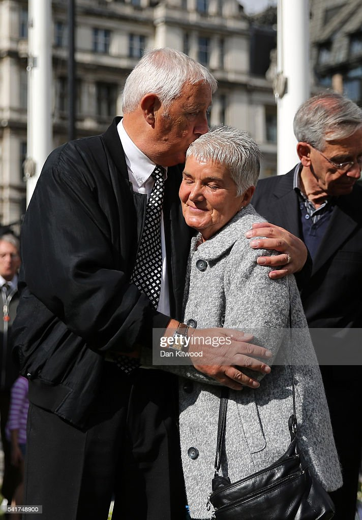 Jean Leadbeater, the mother of Labour MP Jo Cox, is embraced by her husband Gordon Leadbeater in Parliament Square after the service on June 20, 2016 in London, England. Parliament was recalled from recess today so MPs could pay tribute to Jo Cox, Labour MP for Batley and Spen, who was murdered in her constituency last Thursday.