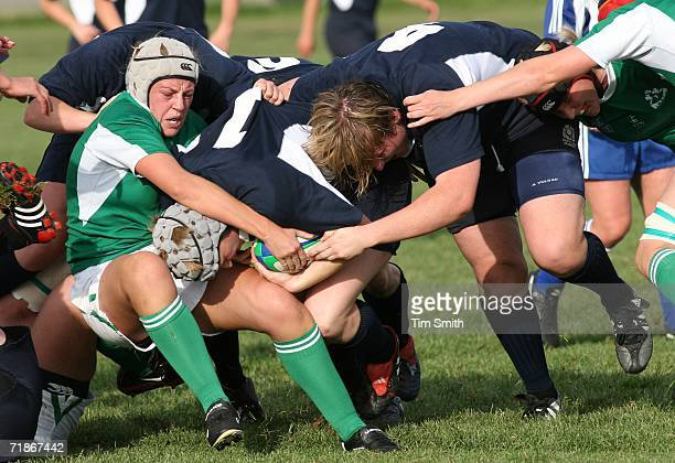 Jean Lonergan of Ireland fights for the ball with Lynne Reid of Scotland as Scottish teammate Jilly McCord applies pressure during day four of the...
