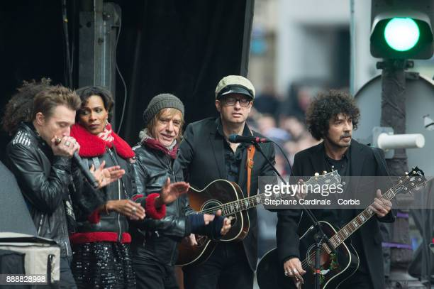 Jean Louis Aubert and Yarol Poupaud are seen during Johnny Hallyday's Funeral at Eglise De La Madeleine on December 9 2017 in Paris France France...