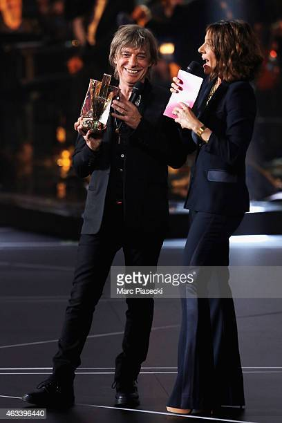 Jean Louis Aubert receives a special prize to celebrate the 30 years of the 'Victoires de la Musique' in Rock category from Virginie Guilhaume during...