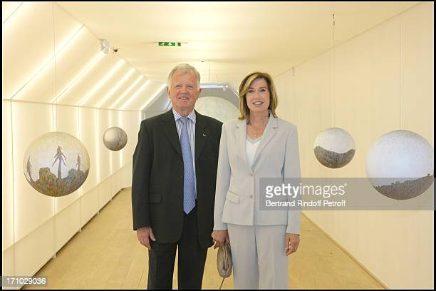 Jean Louis Chretien and Catherine Alric next to the artwork of Russell Crotty Exhibition launch La Tentation de L'espace at the Louis Vuitton space...