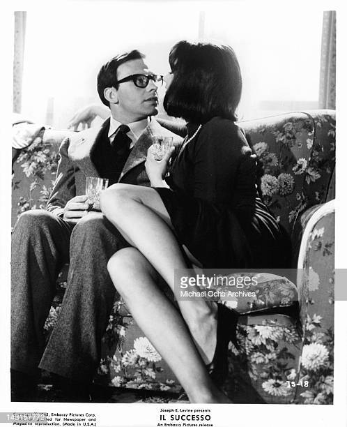 Jean Louis Trintignant and Annie Gorassini getting close on the sofa together in a scene from the film 'Il Successo' 1965