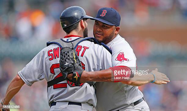 Jean Machi of the Boston Red Sox and teammate Blake Swihart celebrate a win over the Detroit Tigers on August 9 2015 at Comerica Park in Detroit...
