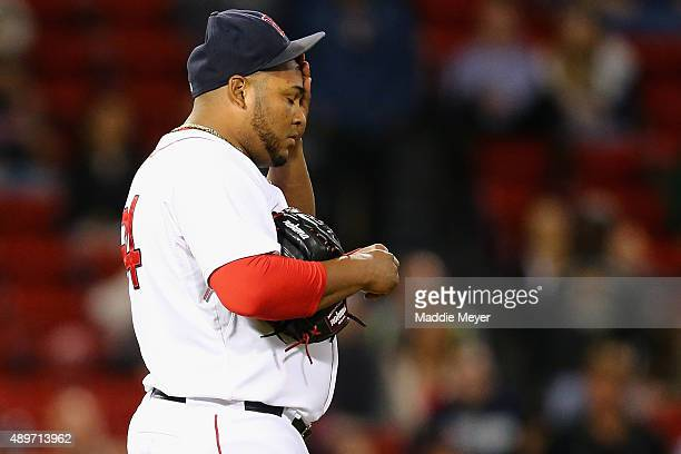 Jean Machi of the Boston Red Sox reacts after allowing Asdrubal Cabrera of the Tampa Bay Rays to hit a home run during the ninth inning at Fenway...