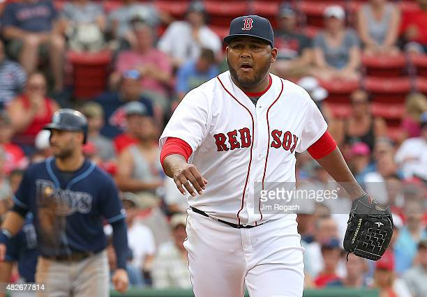 Jean Machi of the Boston Red Sox reacts after the final out against the Tampa Bay Rays of the eighth inning at Fenway Park on August 1 2015 in Boston...