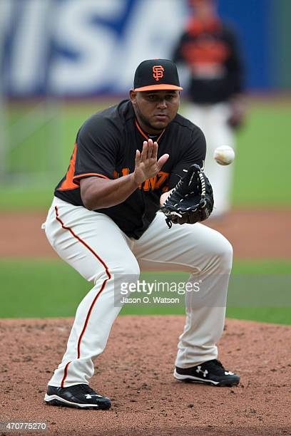 Jean Machi of the San Francisco Giants performs fielding drills during batting practice before the game against the Los Angeles Dodgers at ATT Park...